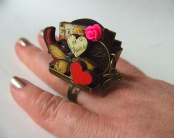The MOST WhimsicaL, Ring, wood, wooden, letters,  mini world, roses,lips, pistol, pink, by NewellsJewels