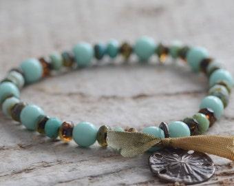 SALE Stretch Bracelet Sand Dollar Charm Bracelet Vintaj Brass Charm Teal and Earthy Brown Czech Glass Beads