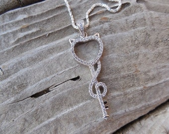 Little devil key necklace in sterling silver with cz's