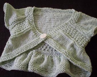 Hand knit baby girls light green bolero