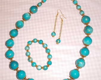 Now 45% off .... 3 Piece Jewelry Set in Turquoise Blue with Gold Swirl Acrylic Beads.   Matching Bracelet and Long Dangle Earrings