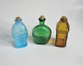 Set of Three Small Colored Bottles / Decorative