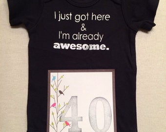 DISCOUNTED -- Nearly Perfect -- #40b, see photos -- I just got here & I'm already awesome.  -- black snapsuit, size 0-3 months
