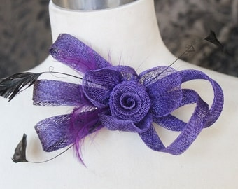 Cute purple   color    flower  with feather  clip  back 1 piece listing big size