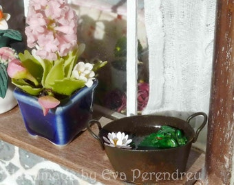 Rusty tub with frog and waterlilly or lotus for your miniature garden or terrarium