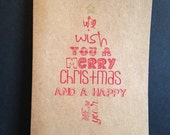 we wish you a merry christmas and a happy new card. christmas card. greeting card. kraft card. christmas tree. word art.