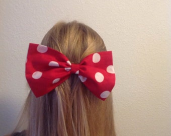 PLEASE READ description before you order bow is on an ALLIGATOR clip large pink or  red  polka dot bow app. 7 X 4