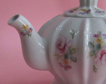 Pink roses with yellow and purple flowers teapot
