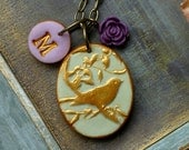 Custom Letter Bird and Flower Necklace in purple