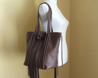 Brown leather handbag tote with fringe and flower by Tuscada. Made to order.