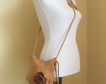 brown, camel leather handbag messenger with flower and 'leaf' fringe by Tuscada. Ready to ship.