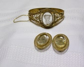 Vintage Whiting and Davis White lady cameo under glass in lacy gold tone bracelet and matching clip earrings