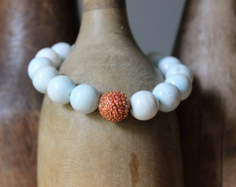 Simple hemimorphite bracelet with coral pave bead