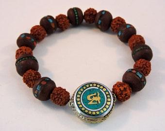 Embedded bodhi seed Rudraksha wrist Mala Medicine Bracelet Turquoise Om bead free silk pouch