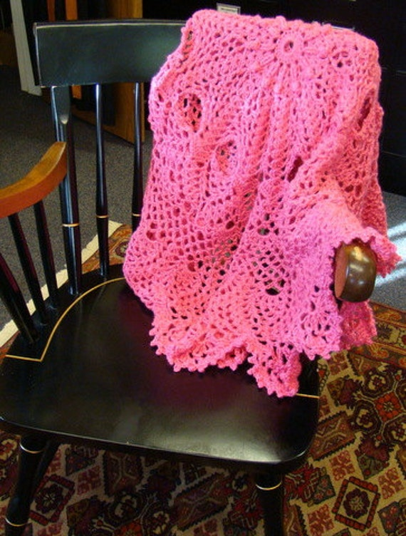 Crocheted circular doily afghan with pineapples and popcorn stitching in salmon pink