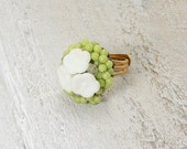 Ring repurposed vintage. Green and white floral. Gold tone and adjustable.  Beautiful and one of a kind.