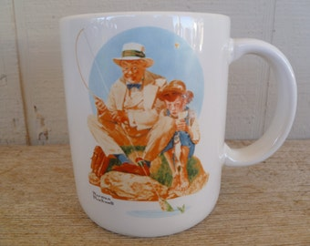 "Norman Rockwell Coffee Mug Cup ""Catching the Big One!"""