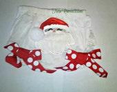 Christmas bloomers with polka dot ribbon and Santa face.