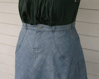 Plus size Knee length, bias cut denim skirt with wraparound hip pockets and zipper fly