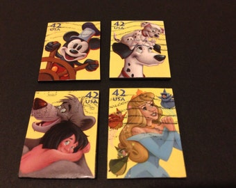 Four (4) Recycled Postage Magnets: Disney, Mickey Mouse, sleeping beauty, 101 Dalmatians, jungle book