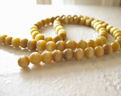 Supplies - Strand of Round Cats Eye Beads