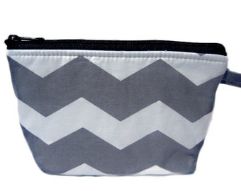 Chevron grey  white colors. make up bag. We have other colors
