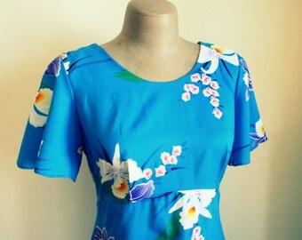 1970s HAWAIIAN DREAM Dress....size small to medium.... mod. dreamy. maxi dress. 1970s dress. blue. vacation. hukilau. floral dress. scoop