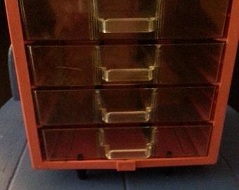 Mid Century coral 4 drawer storage cabinet