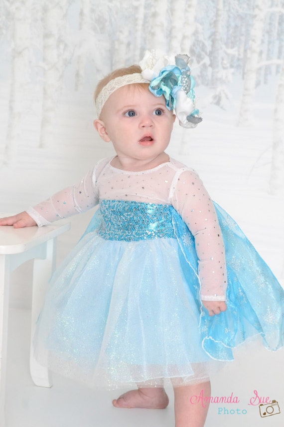 Baby Barbie is super excited. She is having a dress fitting session to find the prettiest Frozen princess costume for a fancy dress party coming up soon at her school/5().