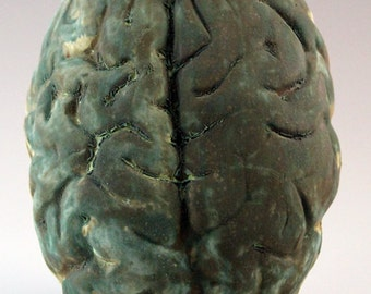 ceramic brain wall sculpture with lichen glaze and terracotta