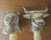The bull and the bear silver figural wine stoppers.  Silver bar ware.