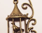 CLEARANCE brass bird in decorative cage charm