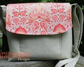 Large sized Messenger bag featuring Tula Pink's Octopus in coral.  Adustable strap in Beige with pockets.
