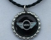 "Mini Cooper  bottle cap necklace with 18"" to 20"" black leather braided necklace"