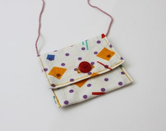 small neck pouch with geometrical pattern in purple, yellow, red and blue / small coin purse