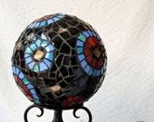 Garden sculpture, mosaic ball made from broken china, black, red, turquoise, circular patterns