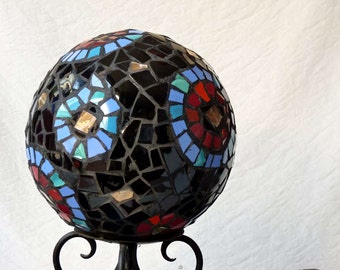 Garden sculpture, mosaic ball made from broken china, black, red, turquoise, circular patterns