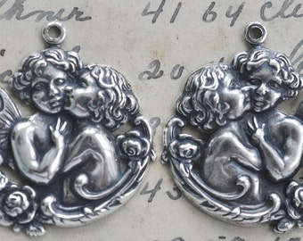 TWO Kissing Cherubs brass pendants, Left and Right, Sterling Silver Finish