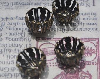 FOUR small basket bead caps, oxidized brass