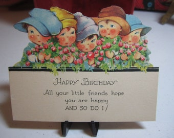 Adorable unused die cut 1920's birthday card from all your little friends 5 rosy cheeked hatted children holding flowers charles twelvetrees