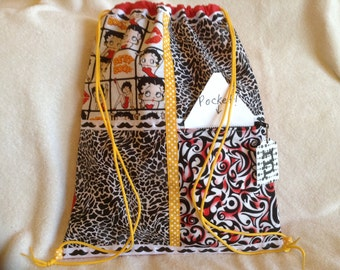 Betty Boop mustaches and animal print on a red ripstop nylon drawstring backpack with front zipper pocket
