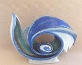 The Third Eye White-blue and green  bird sculpture.Circle bird. Bird with egg..Contemporary ceramic bird