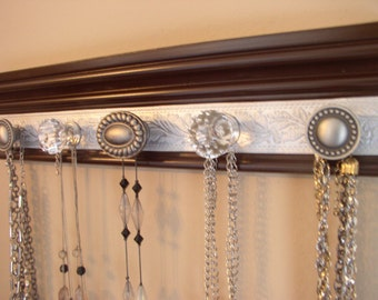 "jewelry holder. This necklace organizer has 5  knobs on brown moulding with silver embossed background 15"" wall hanging jewelry storage"
