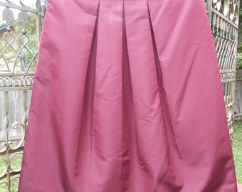 Prada vintage wine pleated skirt made in Italy with two hidden side pockets