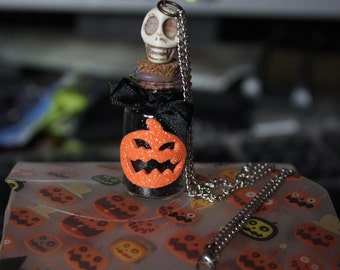 Halloween themed goth glitter alchemy bottle necklace