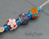 Orange, Turquoise and Purple Flowers, rounds Lampwork bead mini set (3 + 4 spacers, 7 beads) SRA
