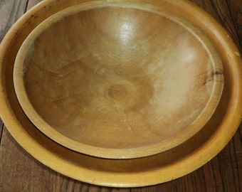 2 REAL BLOND BOWLS!  A pair of solid wooden nesting bowls finish with well developed patina which adds rustic country charm and style