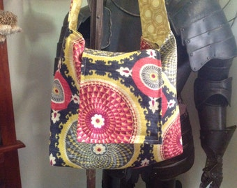 One of a kind multi-color Over the Shoulder/Cross over Bag/Purse. Reversible cross body. Other colors
