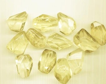 12 large pale yellow quartz faceted nuggets - average size 30 x 22 mm