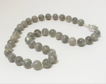 Luscious soft gray labradorite  with occasional flashes  of blue